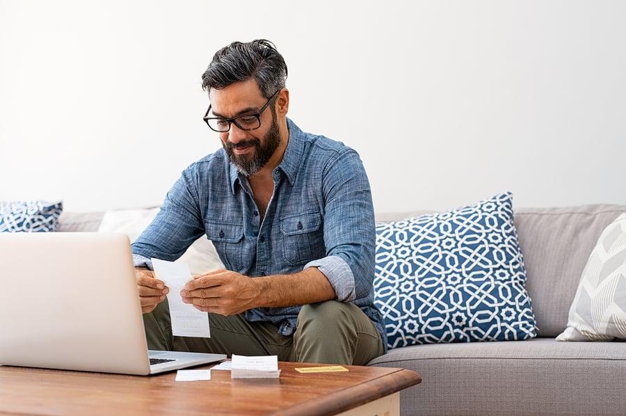 Man working on his family savings